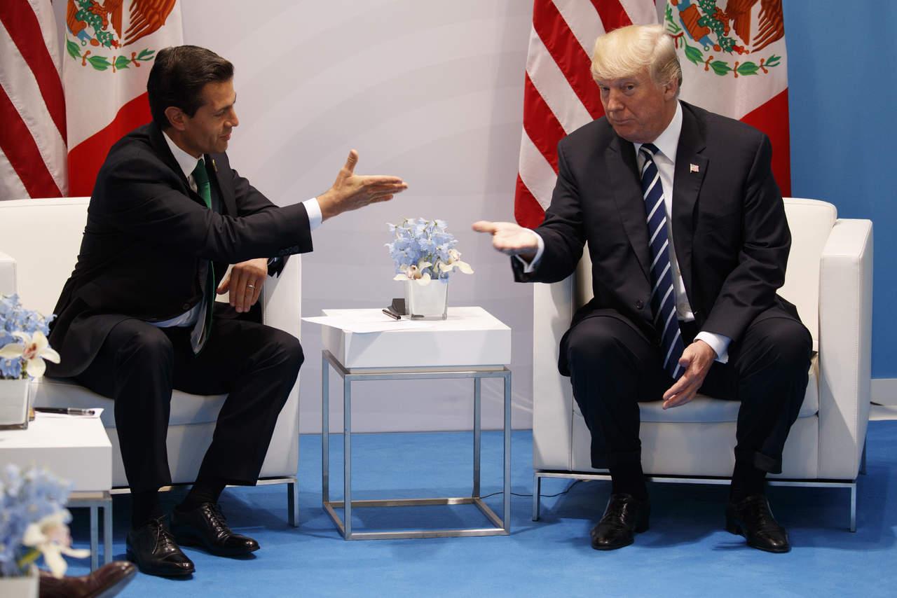 México pagará por muro, insiste Trump tras reunión con EPN